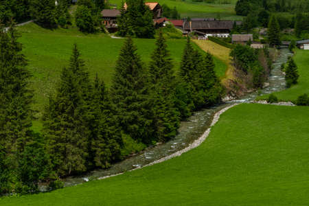 Valley near Kreealm waterfall in Austria Alps mountains on big wall near Kree village 写真素材