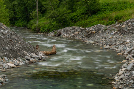 Valley with color small river in Austria Alps mountains near Kree village 写真素材