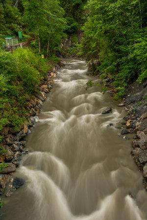 Grossarlbach creek after rainy night near Liechtensteinklamm deep valley with big waterfall