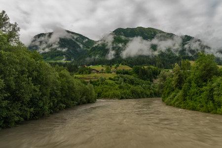 Confluence of Salzach river and Grossarlbach creek near Schwarzach im Pongau town in summer cloudy morning 写真素材