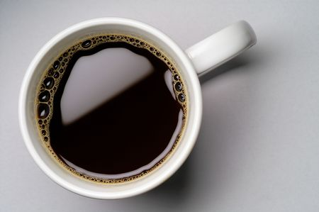 coffee hour: Coffee cup on grey background (seen from above)