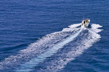 headway: Motorboat speeding ahead at full power  leaving straight wake behind   Stock Photo