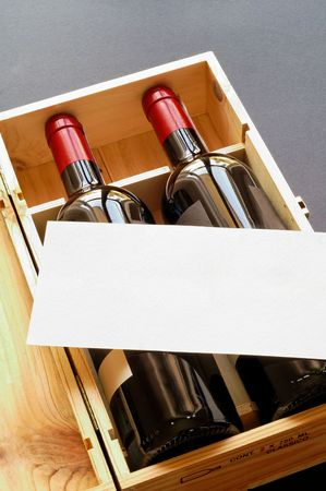 Wood gift box with two wine bottles and blank card (vertical) photo