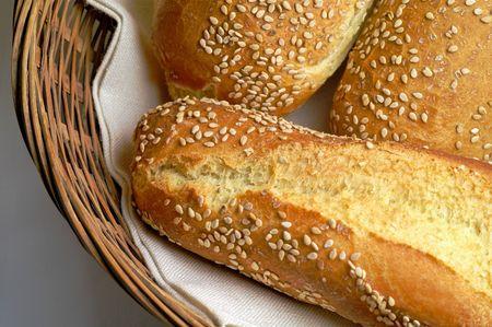 Durum wheat bred rolls in basket (2) photo