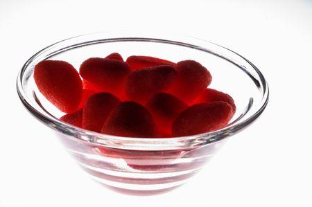 グラスに赤いゼリー菓子光テーブル (下から照らされ) 写真素材