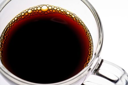 coffee hour: Coffee in glass  cup on white background (seen from above) closeup