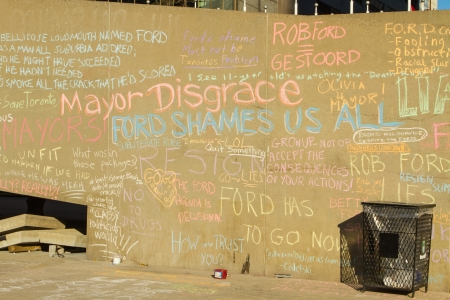 allegations: TORONTO - NOVEMBER 13 - Writings on the wall outside at Nathan Phillip Square by people protesting against Mayor Rob Ford November 13, 2013 Toronto, Canada