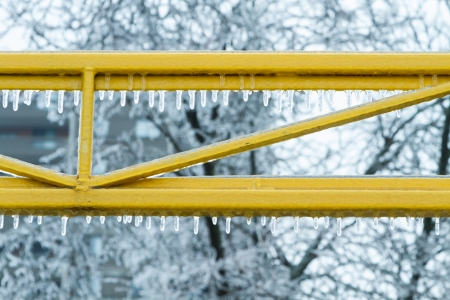 Icicles on bars formed during freezing temperature Stock Photo