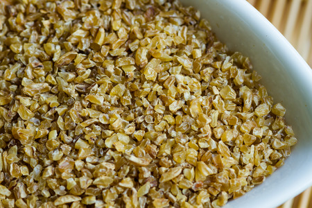 Bulgur wheat on a white cup