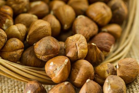 Raw hazelnuts in a basket Stock Photo