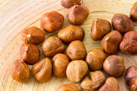 Hazelnuts on wooden plate
