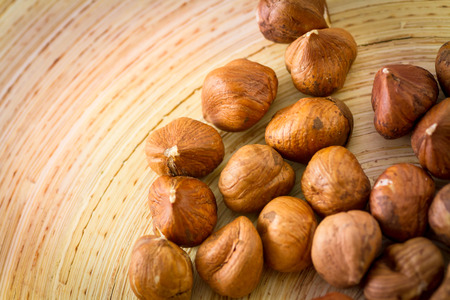 Hazelnuts on wooden plate