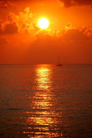 Sailingboat at sunset photo