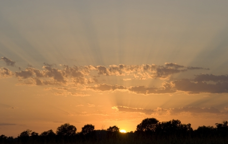 Sunset with visible sunbeams  photo