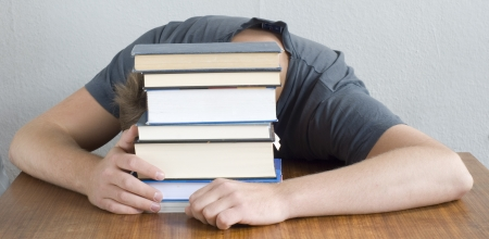 Student studying hard and sleeping with his books. photo