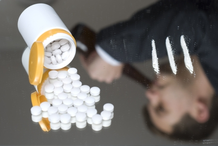 addiction drinking: Narcotics on a mirror. Out of focus reflection of a drinking businessman. Stock Photo