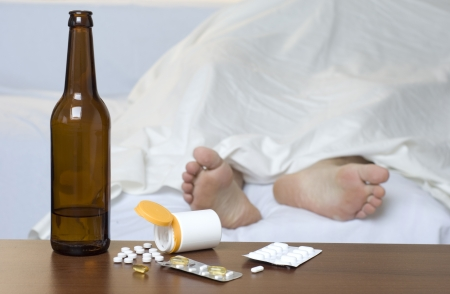 Passed out: Person passed out in the bed after mixed use of alcohol and drugs.