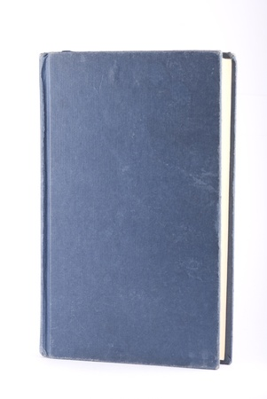 Old blue book isolated on white. Vertical composition.