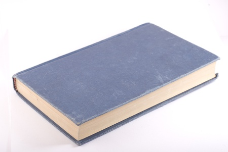Old blue book isolated on white. Diagonal composition.