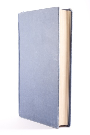 Old blue book isolated on white. Vertical composition, diagonal view.