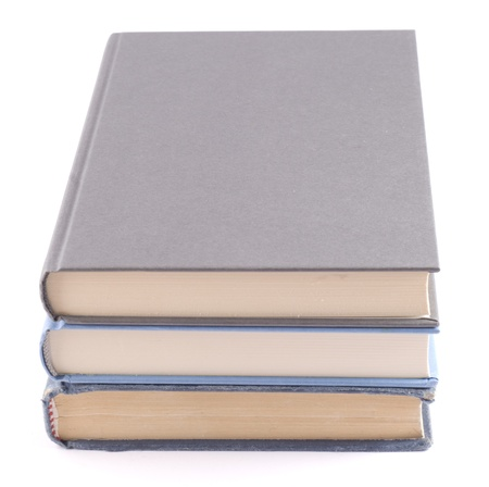 Three books in a pile, isolated on white.