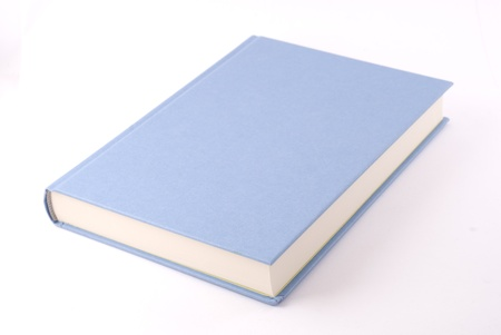 Light blue book isolated on white. Diagonal composition.