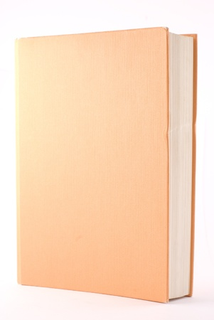 Orange book isolated on white. Vertical composition. Zdjęcie Seryjne