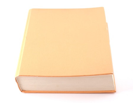 Orange book isolated on white. Frontal diagonal composition.