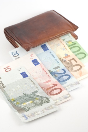 Euro banknotes coming out from a wallet. Isolated on white.