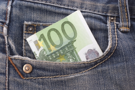 one hundred euro banknote: One hundred euro banknote in the jeans pocket.