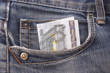 Five euro banknote in the pocket of jeans.
