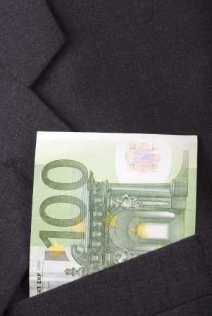 one hundred euro banknote: One hundred euro banknote in the pocket of a dark suit.