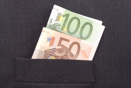 Euro banknotes in the pocket of a dark suit.