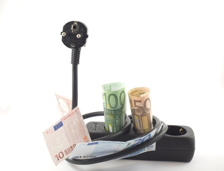Electricity cable, plug and socket covered with banknotes. photo