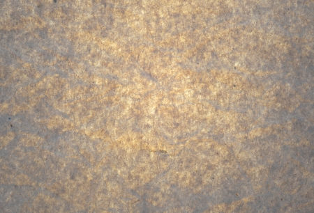 Brown paper with bright center and darker corners.