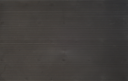 Dark horizontally striped rubber background.