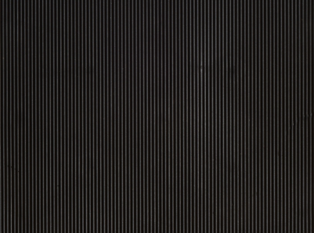 Vertically striped black rubber background. Zdjęcie Seryjne