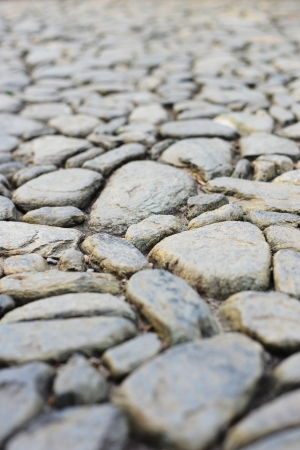 Close-up of an old stone road. Shallow depth of field.