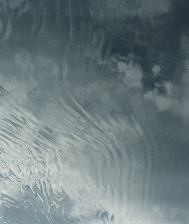 grey water: Abstract soft image of water, waves, sky and clouds.