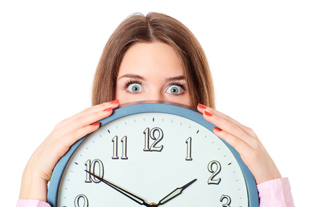 Woman holding clock  with wondering eyes.
