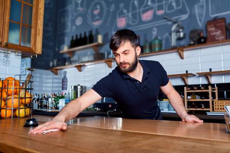 wiping: Bartender wiping down bar counter