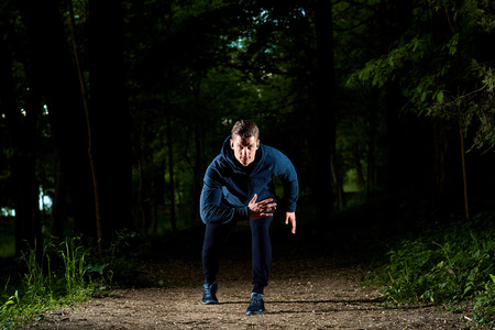 scamper: Sports man running at night.
