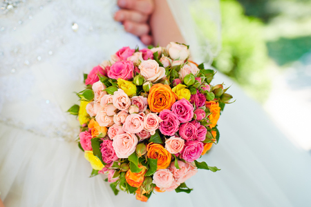 arm bouquet: Beautiful wedding bouquet of roses in hands of the bride Stock Photo