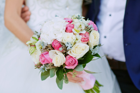 arm bouquet: Beautiful wedding bouquet of flowers in hands of the bride Stock Photo