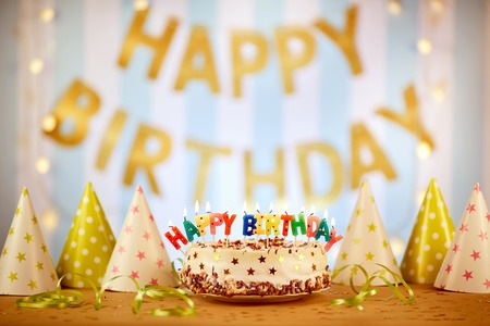 topper: Cake birthday candles with letters in vintage style.