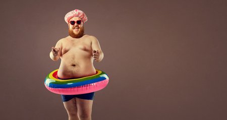 Fat funny man in an inflatable ring circle.