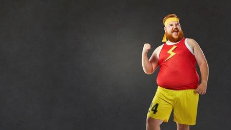 スポーツ服の大きな脂肪裸男。 写真素材