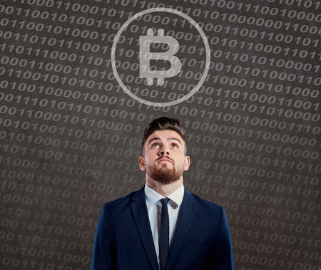 Businessman looking with question at bitcoin. Stock Photo