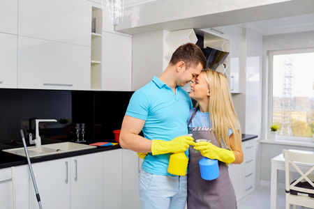 Young couple doing cleaning in the house. Home cleaning.