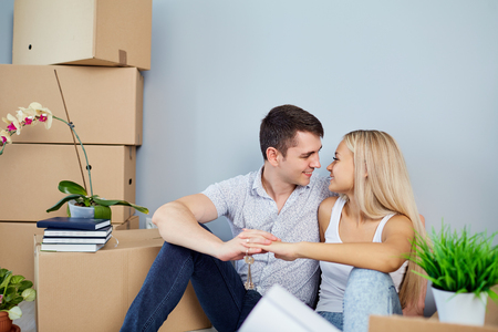 Young couple moving to a new apartment. Housewarming.
